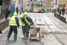 Tram tracks workers royalty free stock photo