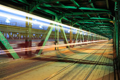 Tram in traffic on the bridge at night Stock Image