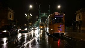 Tram Traffic Budapest. Tram traffic in Budapest closeup at the Liberty Bridge in Budapest by night, scene where two trams pass each other stock video footage