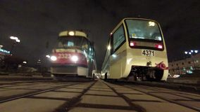 Tram traffic at night. MOSCOW: MAR 07, 2015: Tram traffic at night on Komsomolskaya square in Moscow stock video footage