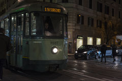 Tram between traffic at night in Rome, Italy Royalty Free Stock Image