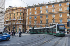 Tram between traffic in Rome, Italy Royalty Free Stock Image