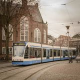 Tram train in Amsterdam Netherlands. March 2015. Squared format stock photos