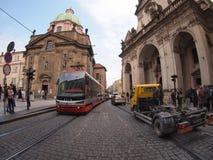 Tram on the tram rails and trucks on the narrow streets of Pragu Stock Image