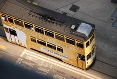 Tram transport in Hong kong. Tram works as the public transport in Hong Kong island. As the tramcars always move between high buildings, it is hard to get Stock Image