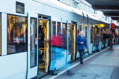 Tram with travelers in motion blur Royalty Free Stock Photos