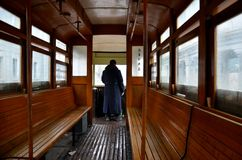 Tram trolley driver and interior wooden benches Royalty Free Stock Photos