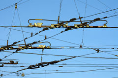 Tram and trolleybus wires. In the sky Royalty Free Stock Image