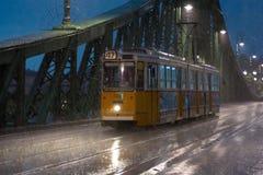 Tram under heavy night rain Royalty Free Stock Images