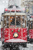 Tram under snow rain at Istiklal Street, Beyoglu, Turkey.  Stock Image