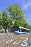 Tram waiting for green light in Amsterdam Royalty Free Stock Image