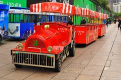 Panorama of the famous Nanjing Road in Shanghai China. Tram waiting for passengers in the beautiful and famous Nanjing Road in Shanghai China. Nanjing road is Stock Image