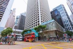 Tram and walking people in Hong Kong Stock Photo