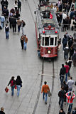 Tram and walking people, Istanbul. Istanbul, Turkey - October 18, 2008: Tram and walking people, Istiklal street, Beyoglu, Beyoglu one of the most famous street Stock Photography