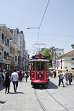 Tram and walking people in Istiklal street Stock Images