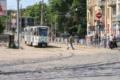 Tram and walking people on the street of Old Town. Lviv, Ukraine Stock Photos