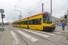 The tram in Warsaw. Warsaw, Poland. April 2019.   A yellow tram on the street in the center of the city stock images