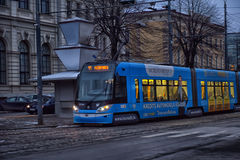 Tram at winter street of Riga town Royalty Free Stock Photo