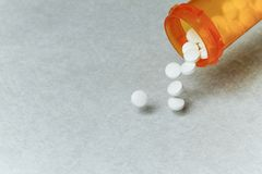 Opioid. Tramadol hydrochloride tablets & x28;opioid& x29; spilling from bottle Stock Images