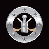 Trame argentée d'étoile avec les bâtons d'hockey et le trophée Images stock