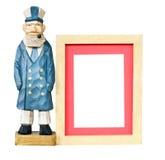 Trame en bois avec le vieux jouet de marin Images stock