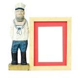 Trame en bois avec le vieux jouet de marin Photographie stock