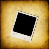 Trame instantanée blanc de photo sur le vieux papier Photos libres de droits