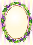 Trame ovale décorative de raisins Photographie stock