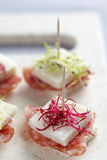 Tramezzini appetizers with salami and sprouts Stock Photography