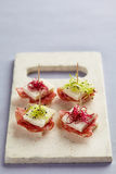 Tramezzini appetizers with salami and sprouts Stock Images
