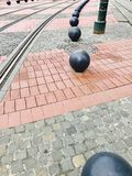 Tramline. Stone street with tramlines with metal balls Royalty Free Stock Photos