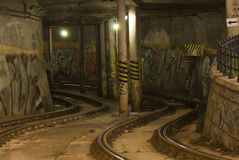 Tramline in the tunnel. Painted with graffiti Royalty Free Stock Image