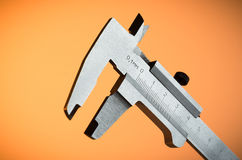 Trammel на оранжевой предпосылке Стоковое Изображение RF