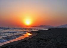 Tramonto ad una spiaggia Fotografia Stock Libera da Diritti