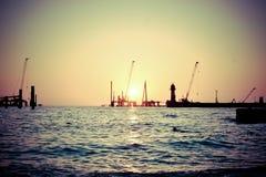 Tramonto al porto Immagini Stock