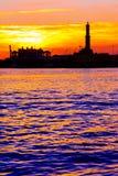 Tramonto al porto del ` s di Genova, siluetta del Lanterna, Italia immagine stock libera da diritti