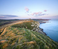 Tramonto alla scogliera di Gad sulla costa giurassica di Dorset Immagine Stock