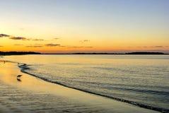 Tramonto alla spiaggia Immagine Stock