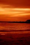 Tramonto alla spiaggia Fotografie Stock Libere da Diritti