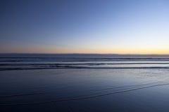 Tramonto alla spiaggia del cannone fotografie stock