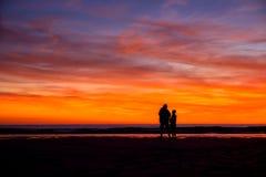Tramonto alla spiaggia di Porth della cappella, in Cornovaglia Fotografie Stock Libere da Diritti
