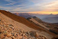 Tramonto alpino rosso Fotografie Stock