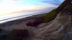 Tramonto Carlsbad California della spiaggia di Ponto stock footage