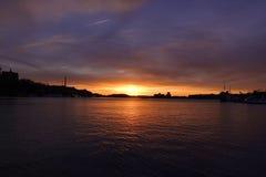Tramonto con la vista del lago Fotografia Stock