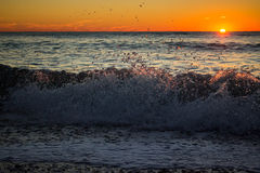 Tramonto con Wave Fotografie Stock