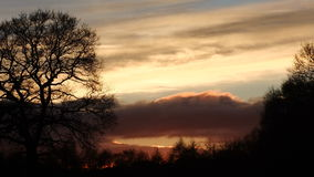 Tramonto del cielo del fuoco Fotografie Stock Libere da Diritti