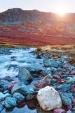 Tramonto del fiume delle montagne Fotografie Stock