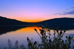 Tramonto del lago Immagine Stock