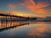 Tramonto del pilastro della spiaggia Fotografie Stock