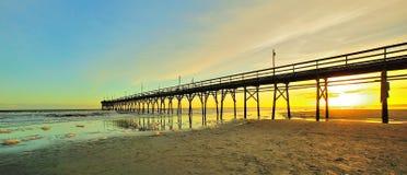 Tramonto del pilastro della spiaggia Fotografia Stock